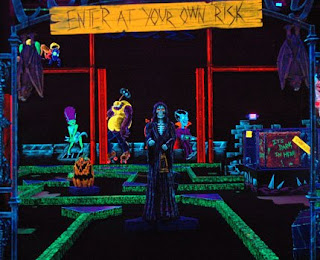 Monsters and skeletons await players on a monster-themed glow in the dark miniature golf course