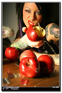 Photo by Jeff Cohn of a goth girl holding an apple with a razorblade sticking out of it