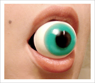 photo of a person eating a rubber eyeball