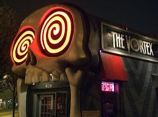 restaurant entrance with a giant skull facade