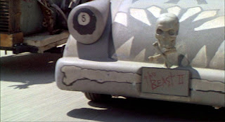 Still from the 1994 film The Little Rascals showing a close-up of the skull and crossbones mounted to the front grill of a go-cart