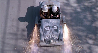 Still from the 1994 film The Little Rascals showing a go-cart painted in a skull motif