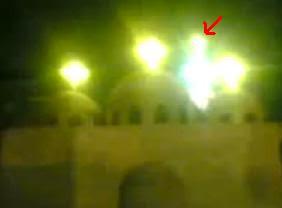 ضوء غامض فوق كنيسة العذراء في منطقة الوراق يزعم أنه تجسداً نورانياً للسيدة العذراء