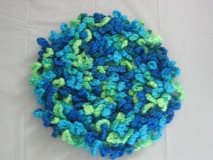 Ravelry: Round Ruffled Pillow (Machine Knit) pattern by Kathy Perry