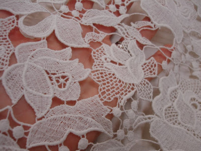 The lace portion at the bodice is this 100 Cotton guipure lace available