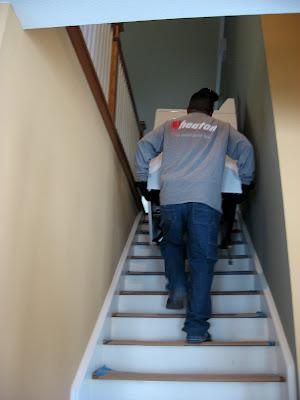 move washing machine up stairs