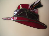 Red hat feathered suncatcher