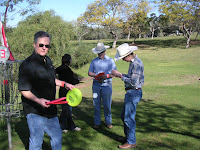 family playing disc golf together