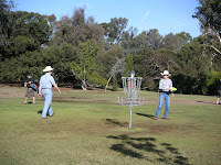 my two cowboys playing disc golf