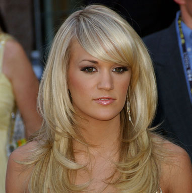 carrie underwood 2010 hair.  hair from a far side like Carrie to create a dramatic sexy effect.