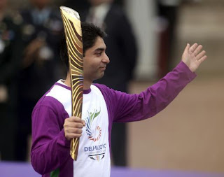 Abhinav bindra with the CWG queen's baton