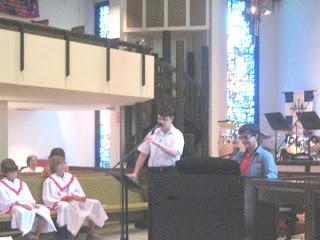 Taylor singing at Grace Church