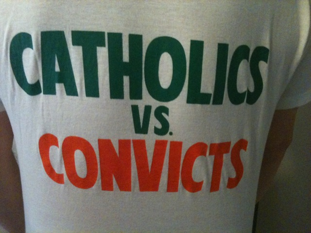 "'88 Miami game T-shirts ""Catholics vs. Convicts—Unfinished Business."""