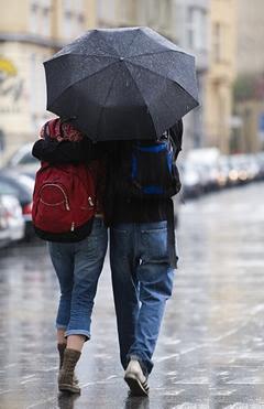 walk hand-in-hand in rain