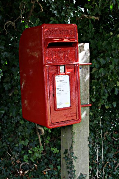 Royal mail pole mounted red letter box