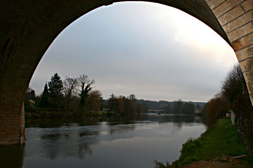 river viewed at dusk from under bridge