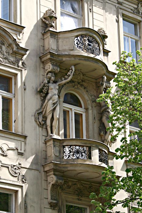 balcony with statues on either side
