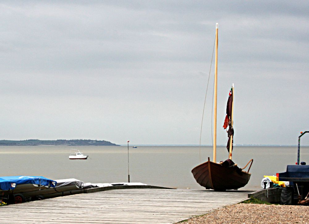 small yacht on foreshore