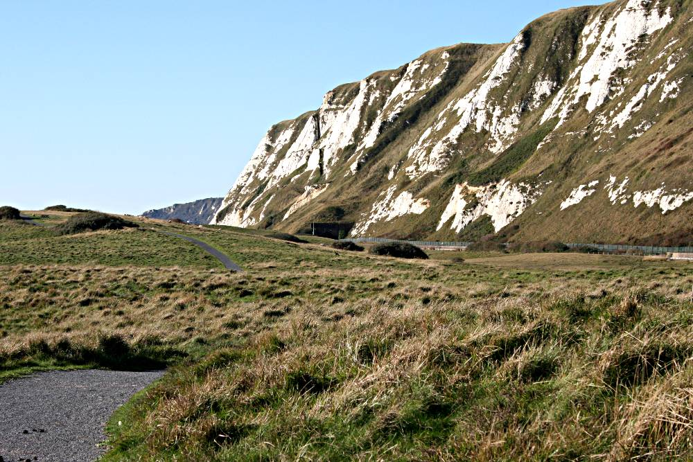 view of white cliffs with railway line in front