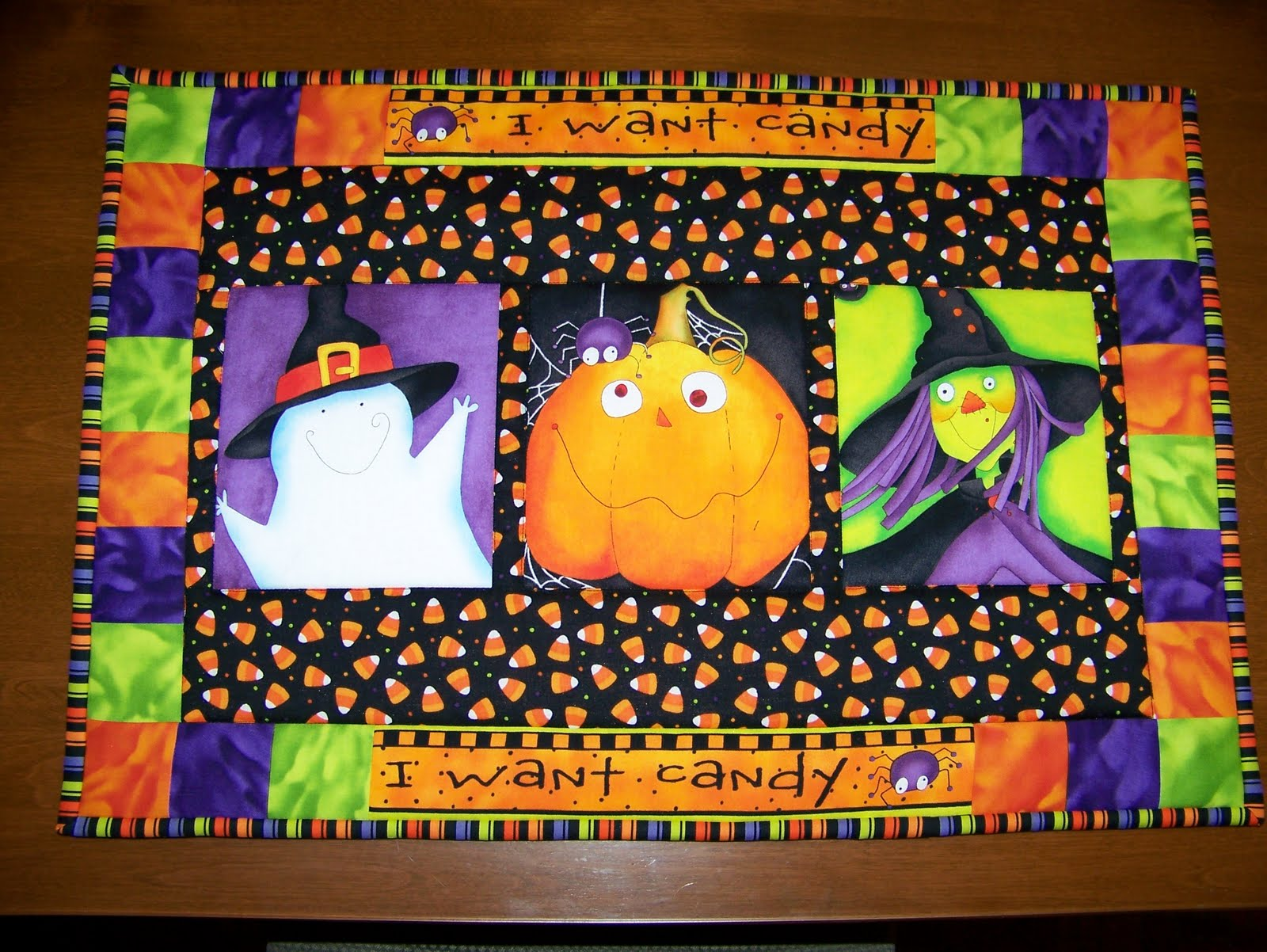 last spring when our quilt club visited quilt shops in the detroit area i found a halloween panel i used parts of the panel to make a table runner