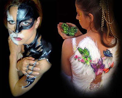 Batgirl Body Painting design with a batman necklace looking 3d. Realistic angel wings with butterfly painted in the hand