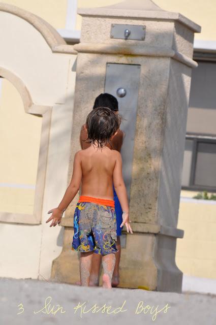 Boy showering.