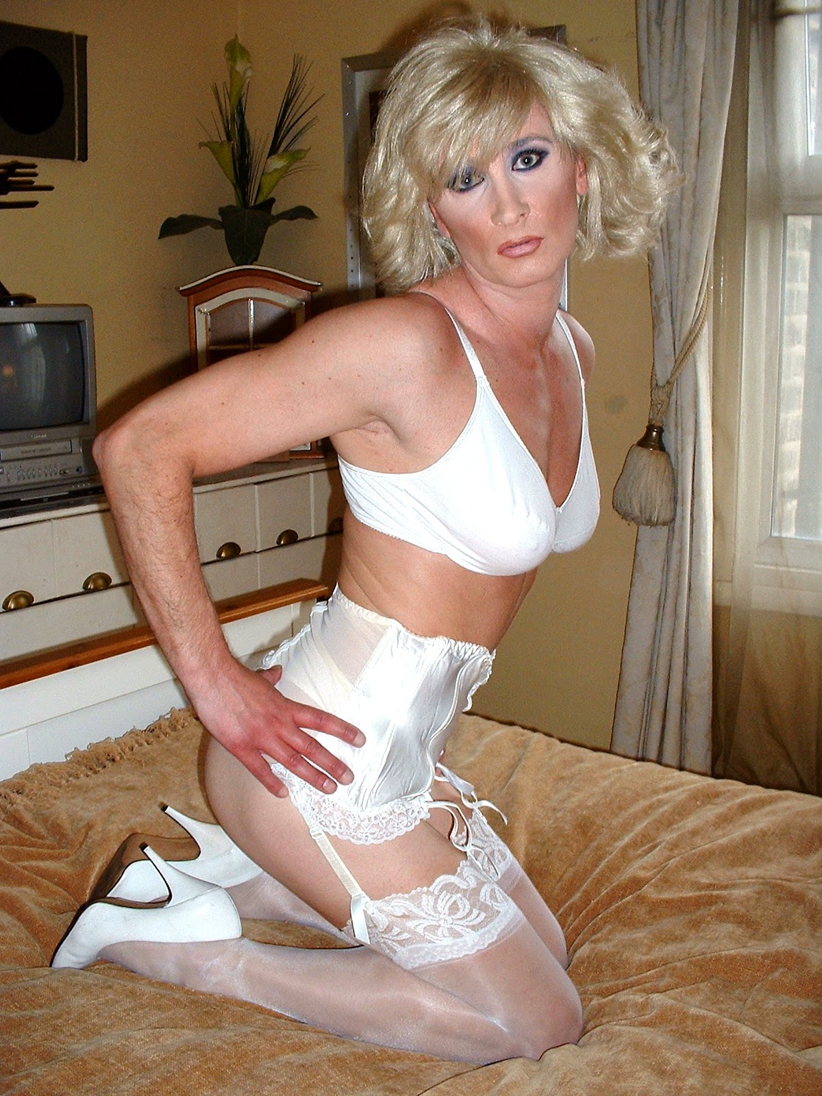 Captions crossdresser girdle
