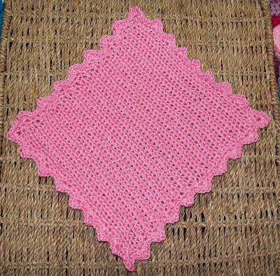 A crochet face cloth