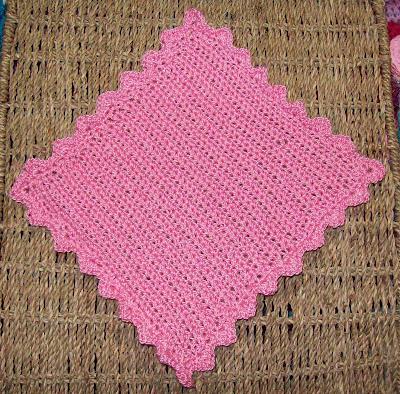 A crochet face cloth