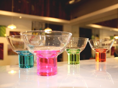 At Relish in Portland OR, bright candy-colored glassware makes a stunning visual merchandising display. giftandhometoday.blogspot.com