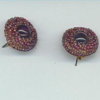 http://4.bp.blogspot.com/_VY63Kc5m5O4/Sx7MR1wAUII/AAAAAAAAAJY/8wF8KDmciSA/s1600-h/earringsamethystcab.jpg