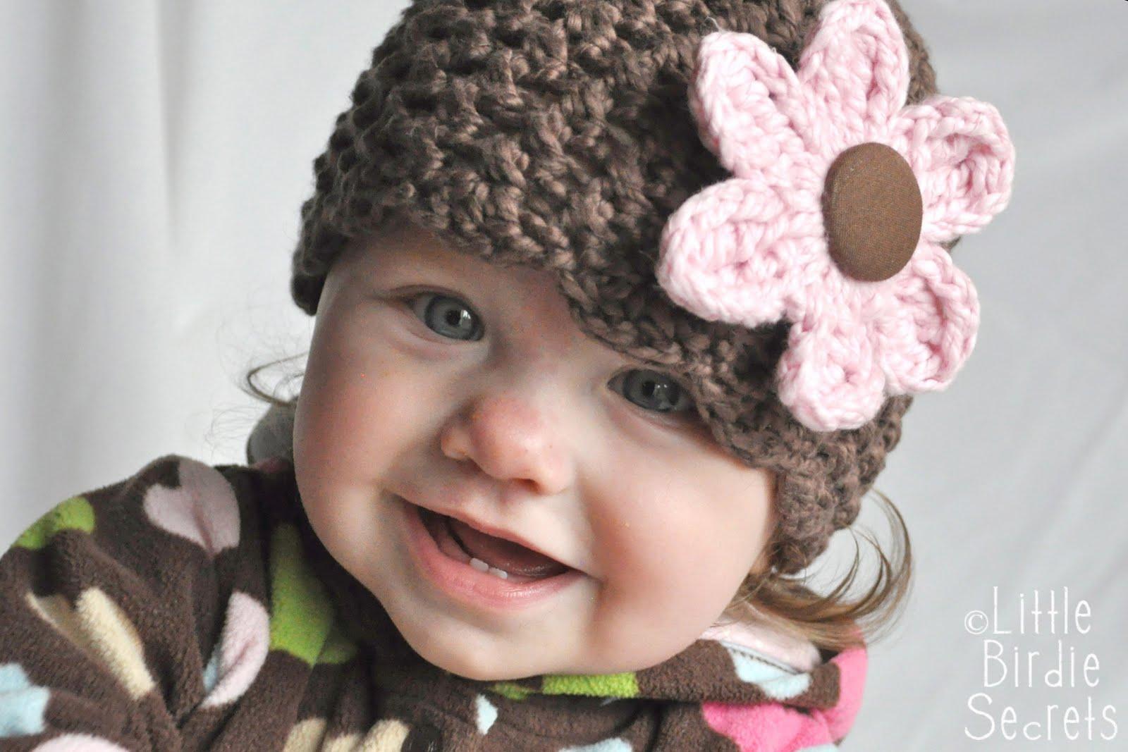 http://4.bp.blogspot.com/_VatJ9ty_tJ0/TMZz5Tre2MI/AAAAAAAAHBA/QBka9_tD-JU/s1600/crocheted%2Bava%2Bhat%2Bwith%2Bflower%2Bcloseup.jpg