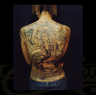 Hip hop lower back tattoos