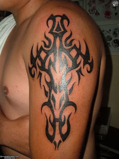 tribal cross arm tattoos design