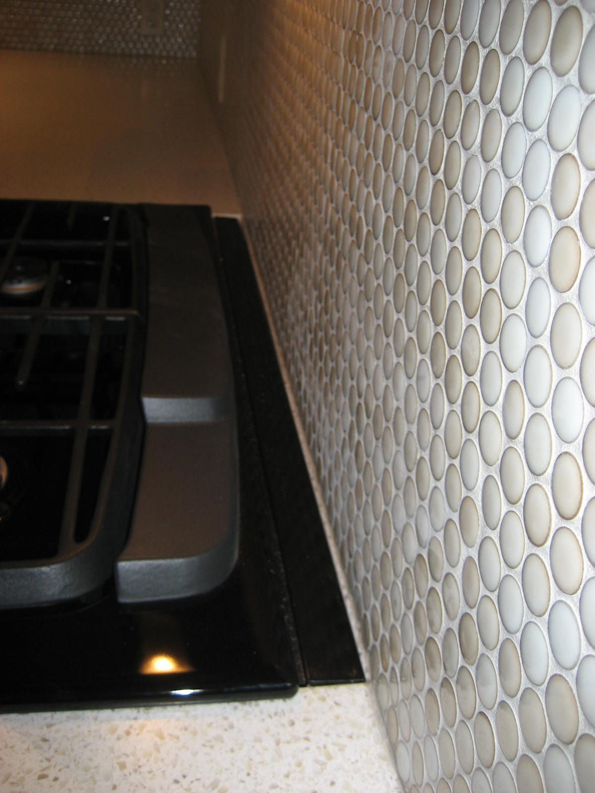 Overall installation of range with countertop strip.