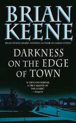 There is a town, and on the edge, itg is dark