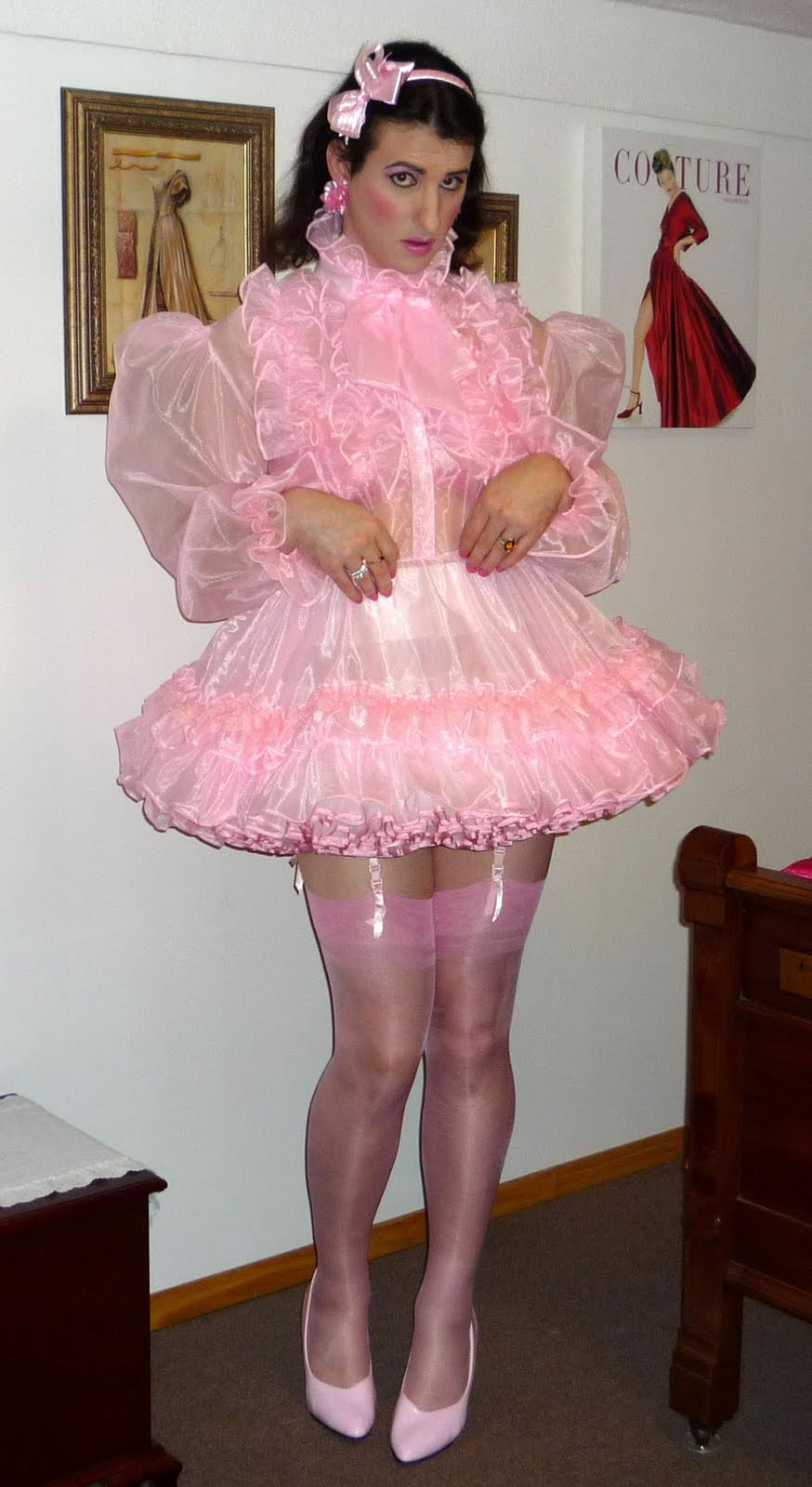 christine this is the best pink sissy dress and i like how she pulls