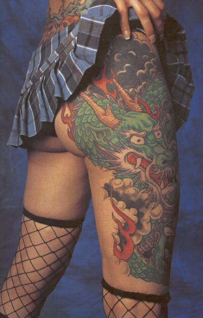 flower tattoos looks very nice sitting on this girls shapely hip.