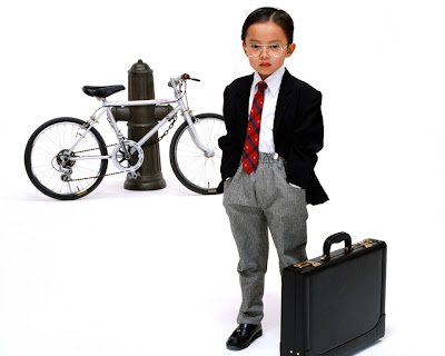child dressed in business suite w/ briefcase