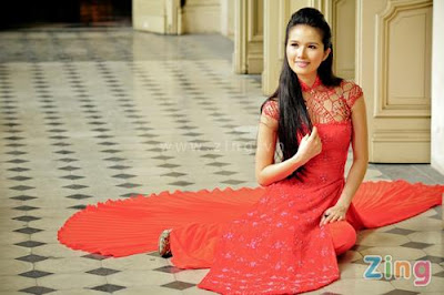 Cao Thuy Duong in red Ao Dai Photos