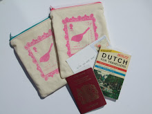 Handprinted travel inspired long zip purses