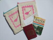 Handprinted travel inspired long zip purses