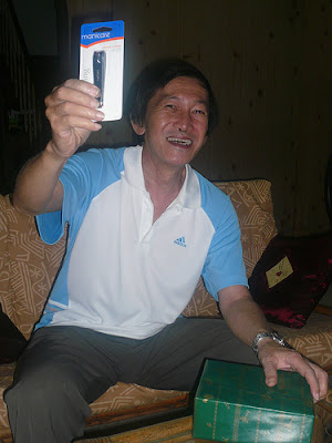 grandfather laughing and holding up the nail clipper