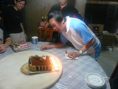grandfather blowing candles