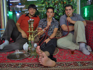 Friends smoking a hookah pipe