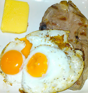 Grilled lamb forequarter chop and fried egg, with butter
