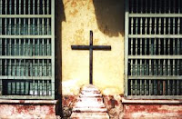 photograph of cross on an outside wall