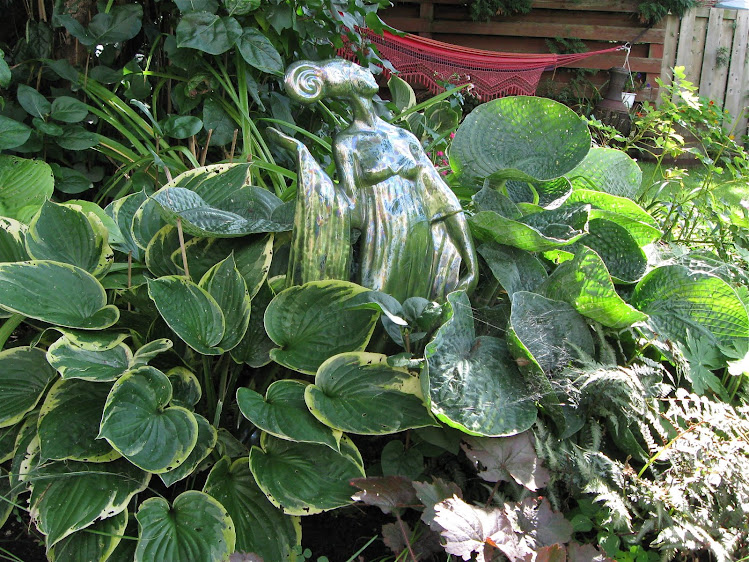 Hostas, ferns and Garden Lady