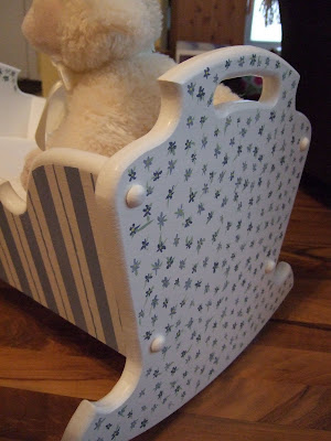 DIY Doll Cradle http://www.toaprettylife.com/2009/08/diy-day-painted-dolls-cradle.html