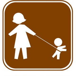 sign with mom holding kid on a leash